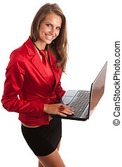 Business woman in red dress working on alptop