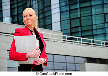 Business woman in red jacket