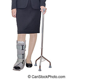 Business woman in suit with an ankle brace and stave
