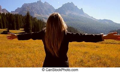 Business woman looking at beautiful nature