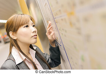 business woman in the MRT station - Asian young business...