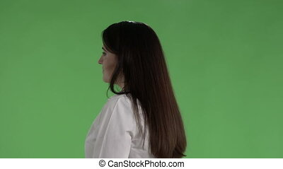Business woman in white shirt against a green screen