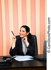 Business woman indicate with pencil