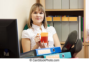 business woman is relaxing in office