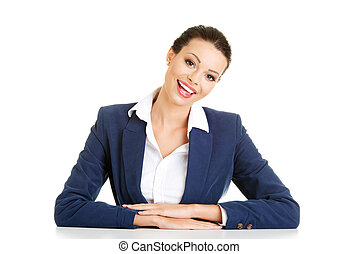 Business woman is sitting at the desk