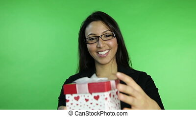 business woman isolated on green screen receiving gift
