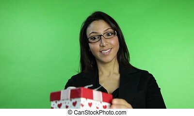 business woman isolated on green screen upset with gift