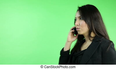business woman isolated on green screen with phone