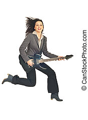 Business woman jumping with guitar