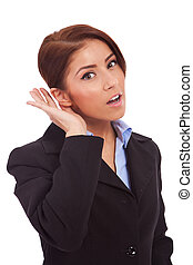 Business woman listening - Business woman with hand to ear ...