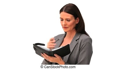 Business woman looking at her diary