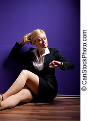 business woman looking at her watch
