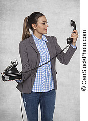 Business woman looking into the phone's headset