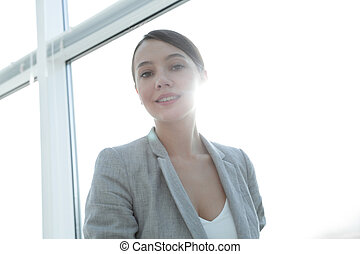 business woman looking out the office window