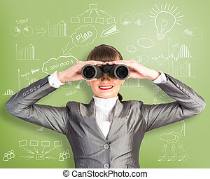 business woman looking through binoculars