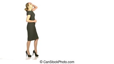 Business woman looking up - full length - Business woman is...