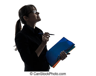 business woman looking up  holding folders files silhouette