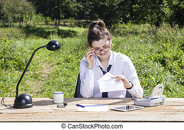 business woman looks into the envelope with a bribe