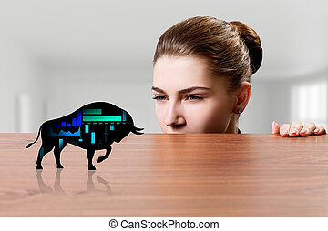 Business woman looks on black silhouette bear financial icon.