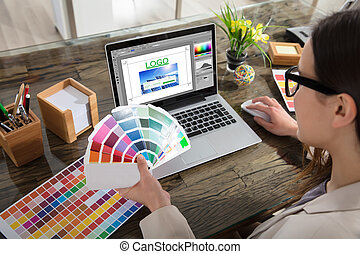 Business Woman Making Color Selection For Logo Design