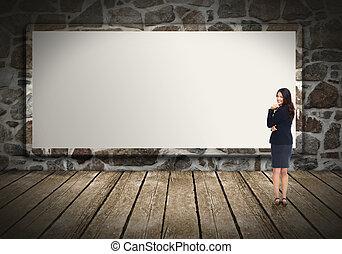 Business woman near billboard.