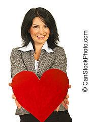 Business woman offering heart