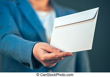 Business woman offering white envelope as bribe