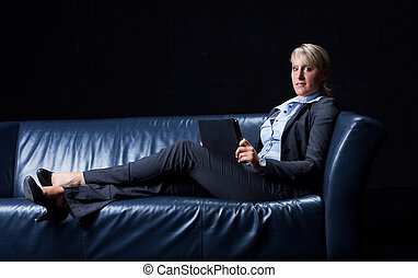business woman on a couch