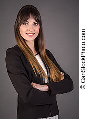 Business woman on a gray background. Office worker