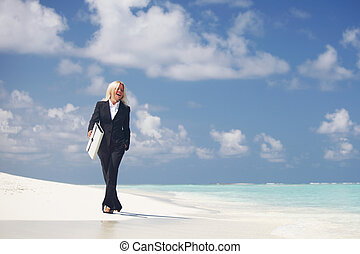 Business woman on beach
