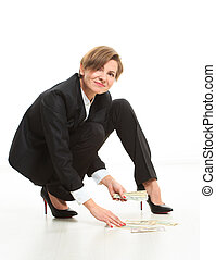 Business Woman On Floor Grabbing Up Cash.