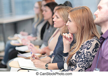 business woman on the background of colleagues in the conference room