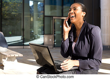 business woman on the phone with a laptop