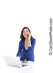 Business woman on the phone with laptop