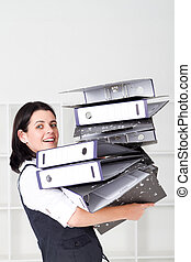 Business woman overloaded with file
