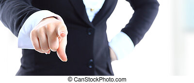 Business woman point finger at you. Isolated on white background