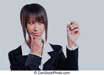 Business woman pointing at white background.