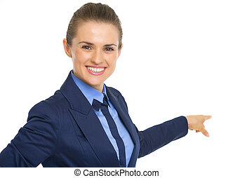 Business woman pointing behind on copy space