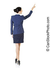 Business woman pointing on copy space