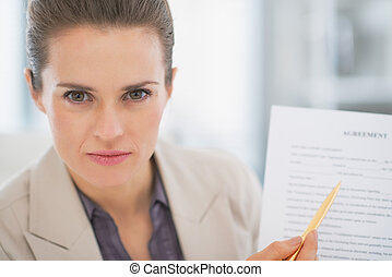 Business woman pointing on document