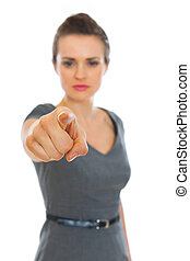 Business woman pointing on you. Focus on finger