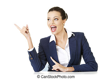 Business woman pointing to empty copy space