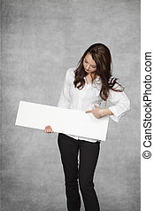 business woman pointing to the empty space