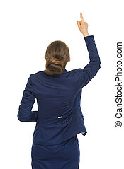 Business woman pointing up on copy space. rear view