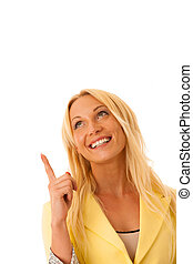 Business woman points into copy space isolated over white background