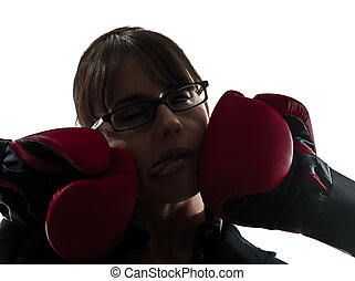 business woman punched  by boxing gloves silhouette