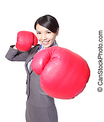business woman punching by boxing gloves - Portrait of...