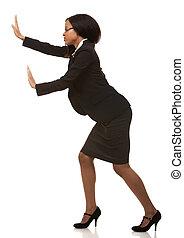 business woman pushing invisible object - beautiful woman ...