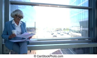 Business woman reading documents at break