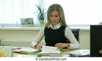 Business woman reading documents in office